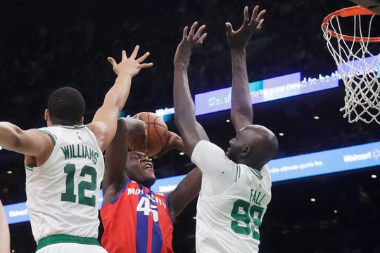 Detroit Pistons forward Sekou Doumbouya goes up against Boston Celtics center Tacko Fall and forward Grant Williams in the fourth quarter Friday, Dec. 20, 2019, in Boston.