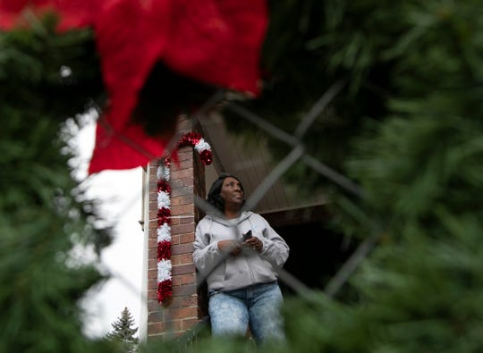 Mama Tu-Tu (aka Wanda Beavers) is pictured on her front porch as she hands out toys and baskets to families in need in Jackson for the holidays Friday, Dec. 13, 2019.