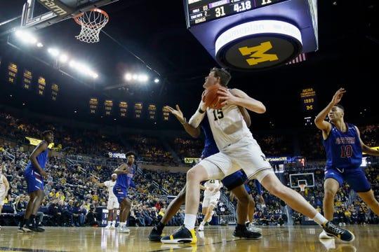 Michigan center Jon Teske looks to shoot the first half on Saturday, Dec. 21, 2019, at Crisler Center.