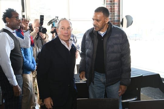 Democratic Presidential candidate Mike Bloomberg is greeted by Alex Albritton of Detroit at Good Times along Detroit's Avenue of Fashion on Saturday, December 21, 2019.