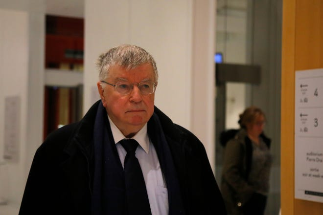 French telecommunications powerhouse Orange former CEO Didier Lombard leaves the court room Friday, Dec. 20, 2019 in Paris.