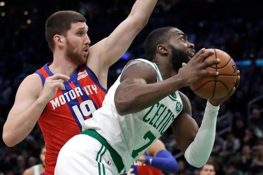Boston Celtics guard Jaylen Brown (7) beats Detroit Pistons guard Sviatoslav Mykhailiuk (19) to the hoop.