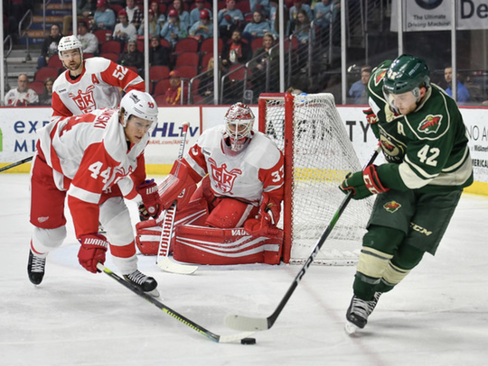 Red Wings goalie Jimmy Howard made 25 saves in Grand Rapids' 4-2 loss against the Iowa Wild on Friday.