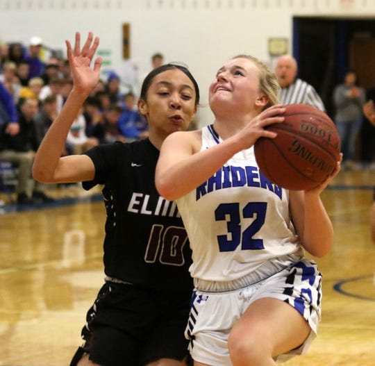 Maddie Johnson of Horseheads goes up for a shot as Elmira's Jalea Abrams defends in girls basketball Dec. 20, 2019 at Horseheads Middle School.