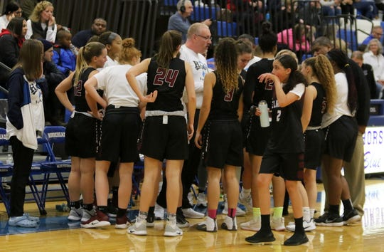 Elmira girls basketball coach Jake Dailey talks to his team during a timeout during Elmira's 58-41 win over Horseheads on Dec. 20, 2019 at Horseheads Middle School.