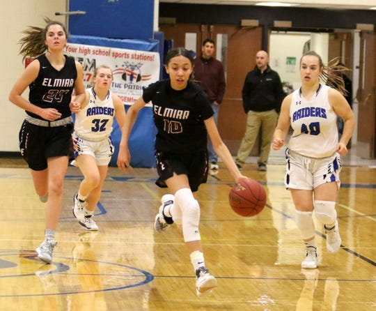 Jalea Abrams dribbles down the court for Elmira alongside teammate Megan Fedor as Horseheads players Maddie Johnson (32) and Tess Cites (40) follow during girls basketball Dec. 20, 2019 at Horseheads Middle School.