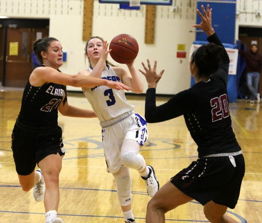 Carly Scott of Horseheads tries to split Elmira defenders Morgan Gentile, left, and Zaria DeMember-Shazer during girls basketball Dec. 20, 2019 at Horseheads Middle School.