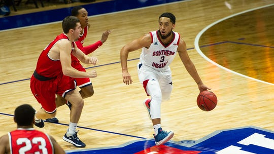USI junior Mateo Rivera looks to pass during Saturday's men's basketball game against King.