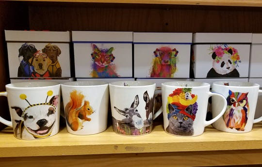 A few of the many darling mugs for sale  at Beans and Baristas.