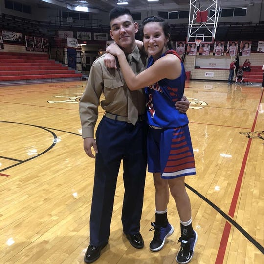 George Green (left) poses with his sister Ella following Thursday's girls basketball game between Tecumseh and Tell City.