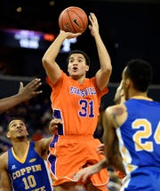University of Evansville's D.J. Balentine shoots over Coppin State's Christian Kessee (10) and Sterling Smith during their game at Ford Center Dec. 29, 2014. Balentine scored a game-high 32 points as the Aces topped Coppin State 85-80.