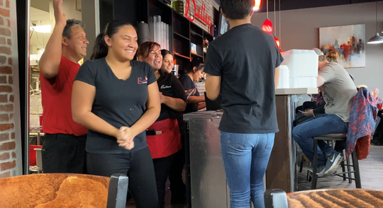 The staff at Butters is all smiles after receiving a $1100 tip in Fort Collins on Dec. 21, 2019.