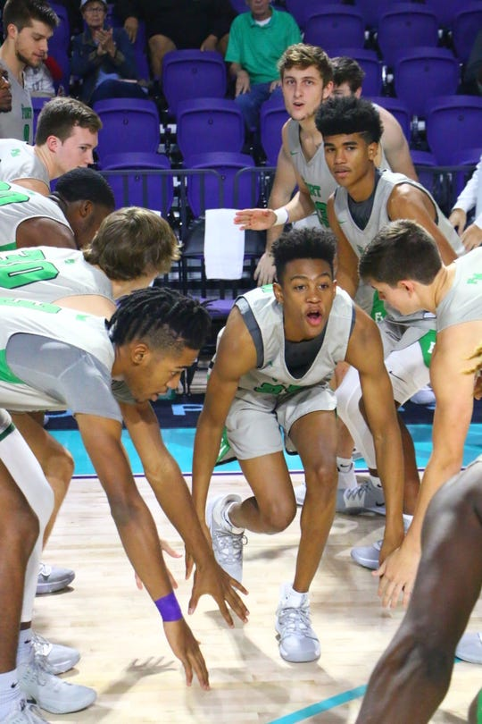 Fort Myers High faced Sanford School from Delaware in a City of Palms Classic consolation semifinal game on Saturday, Dec. 21. Javian McCollum is introduced before the game.