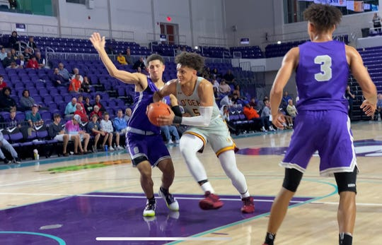 Seattle O'Dea's Paolo Banchero drives to the basket in the fourth quarter of a loss to Washington D.C. Gonzaga in a City of Palms Classic quarterfinal Friday at Suncoast Credit Union Arena.