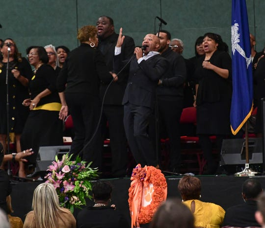 "Anderson Combined Choir sing ""Oh, Give Thanks"" during the funeral for James Robert ""Radio"" Kennedy in the Civic Center of Anderson Saturday."