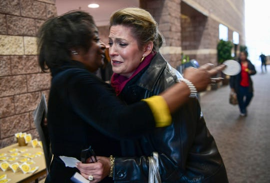 "Colette Davis, left, hugs Lisa McWherter, right, before the funeral for James Robert ""Radio"" Kennedy at the Civic Center of Anderson Saturday."