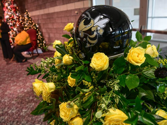 "The wreath with football helmet in the lobby before the funeral for James Robert ""Radio"" Kennedy at the Civic Center of Anderson Saturday."