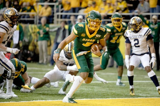 North Dakota State quarterback Trey Lance (5) scores a rushing touchdown during the first half of an FCS playoff NCAA college football game against Montana State University, Saturday, Dec. 21, 2019, in Fargo, N.D. (AP Photo/Bruce Crummy)