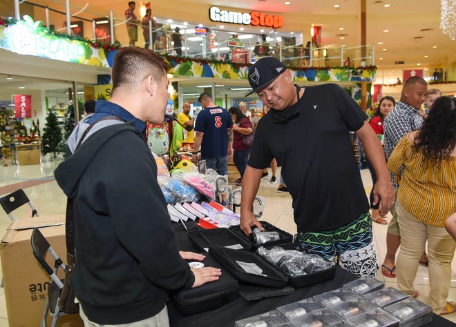 A customer visits the Zvline table at Agana Shopping Center's Holiday Bazaar in this Dec. 21 file photo.
