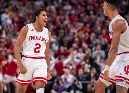 Indiana guard Armaan Franklin (2) reacts with his teammates after hitting the game-winning three-point shot during the second half of game one against Notre Dame of the 2019 Crossroads Classic, Saturday, Dec. 21, 2019, at Bankers Life Fieldhouse. Indiana won 62-60.