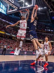 Notre Dame forward John Mooney (33) scores with a slam dunk as he's defended by Indiana guard Al Durham (1) during the second half of game one of the 2019 Crossroads Classic, Saturday, Dec. 21, 2019, at Bankers Life Fieldhouse. Indiana won 62-60.