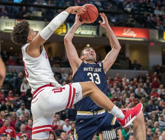 Notre Dame Fighting Irish forward John Mooney (33) is fouled by Indiana Hoosiers forward Justin Smith (3) in the first half at Bankers Life Fieldhouse.