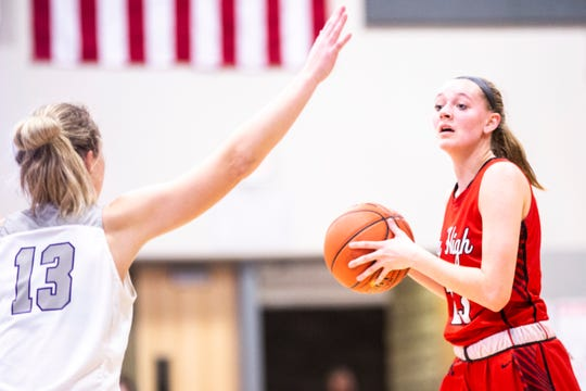 Iowa City High guard Aubrey Joens (23) looks to pass as Liberty guard Sam McPherson (13) defends during a Class 5A girls' varsity basketball game, Friday, Dec. 20, 2019, at Liberty High School in North Liberty, Iowa.