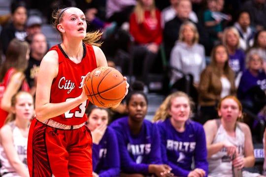 Iowa City High guard Aubrey Joens (23) shoots a 3-point basket during a Class 5A girls' varsity basketball game, Friday, Dec. 20, 2019, at Liberty High School in North Liberty, Iowa.