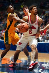 Ole Miss forward KJ Buffen drives in traffic against Southeastern Louisiana on Saturday Dec. 21 at the Mississippi Coliseum in Jackson, Mississippi.