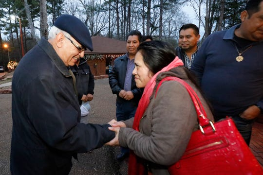 Cardinal Alvaro Ramazzini of Guatemala, is greeted by a Guatemalan immigrant parishioner, at St. Anne Catholic Church in Carthage, Friday evening, Dec. 20, 2019, prior to a listening session with those impacted by the August 7 arrests by immigration agents at seven Mississippi food processing plants. (AP Photo/Rogelio V. Solis)