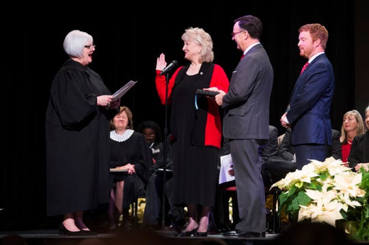 Lynne Fugate takes an oath, administered by Knox County Circuit Court Juge Deborah C. Stevens, at Knoxville Mayor Indya Kincannon's inauguration at the Bijou Theatre in downtown Knoxville, Saturday, Dec. 21, 2019.