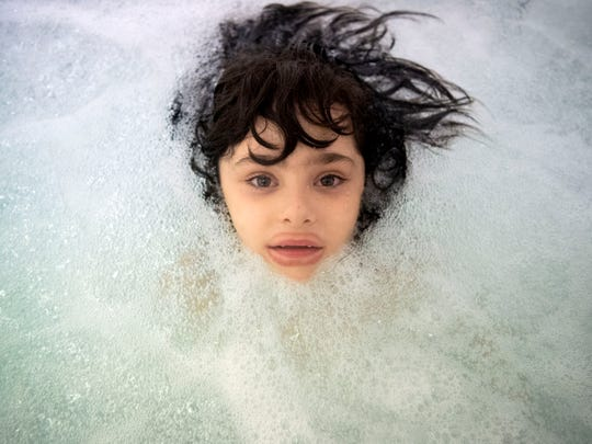 Six-year-old Harrison soaks inside a hydrotherapy pool at Alliance Physical Therapy in Cleveland, Tenn., on Thursday, March 28, 2019. Harrison, who has autism, is one of approximately 220,000 Tennessee children who were purged from enrollment in TennCare or CoverKids. Harrison's mother, Heather Hantz, was able to get her son reenrolled with help from the Tennessee Justice Center and the office of Sen. Bob Corker.