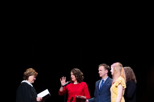 Knoxville Mayor Indya Kincannon is sworn in by Tennessee State Supreme Court Justice Sharon Lee, while her husband and daughters accompany her at her inauguration at the Bijou Theatre in downtown Knoxville, Saturday, Dec. 21, 2019.