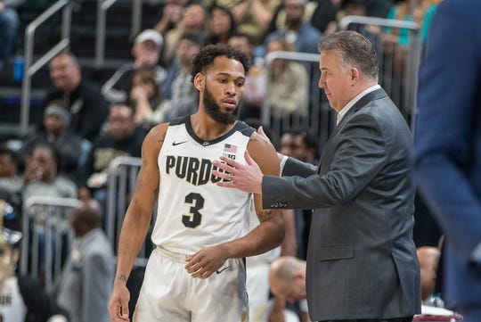 Dec 21, 2019; Indianapolis, Indiana, USA;  Purdue Boilermakers head coach Matt Painter talks with guard Jahaad Proctor (3) on the sideline in the first half against the Butler Bulldogs at Bankers Life Fieldhouse. Mandatory Credit: Trevor Ruszkowski-USA TODAY Sports