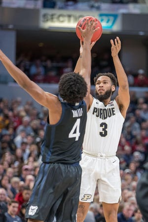 Dec 21, 2019; Indianapolis, Indiana, USA; Purdue Boilermakers guard Jahaad Proctor (3) shoots the ball over Butler Bulldogs guard Khalif Battle (4) in the first half at Bankers Life Fieldhouse. Mandatory Credit: Trevor Ruszkowski-USA TODAY Sports