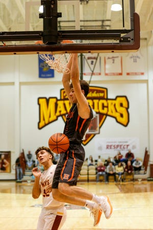 Harrison's Jordan Walters (12) dunks during the fourth quarter of an IHSAA boy's basketball game, Friday, Dec. 20, 2019 in Lafayette.
