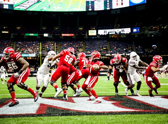 UL's Levi Lewis throws from the end zone at the Superdome during a 2019 season-opening loss to Mississippi State.