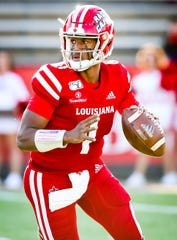 UL junior quarterback Levi Lewis looks downfield during a win over Texas State earlier this season.