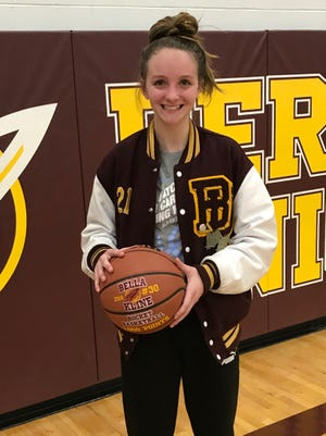 Berne Union junior Bella Kline was presented with a game ball in recognition of scoring her 1,000 career point. Kline, who has been the Rockets' leading scorer the last two seasons, broke the single-game scoring record two weeks ago when she scored 37 points. She has earned All-Ohio honors the last two years.