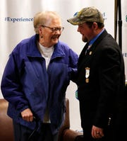 Norma Stoughton, left, and Jon Schneider laugh Saturday morning, Dec. 21, 2019, as they're reunited for the first time since Stoughton found the then 2-week-old infant outside what was then Lancaster-Fairfield Community Hospital shortly after midnight on Dec. 21, 1987. Schneider was reunited with Stoughton and Debbie Totten, both retired nurses, and Fairfield Medical Center Police Chief Steve Anderson Saturday morning, Dec. 21, 2019, at the hospital in Lancaster, Ohio. The three were working at the hospital when Schneider was found.