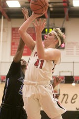 Pinckney's Luke Lovell scores two of his 14 points in a 59-48 loss to Ypsilanti Lincoln on Friday, Dec. 20, 2019.