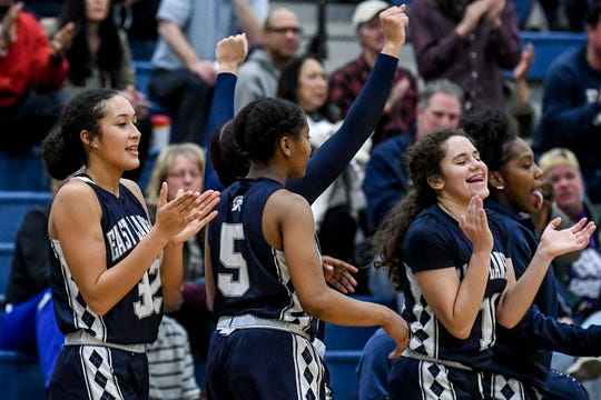 East Lansing celebrates after beating DeWitt on Friday, Dec. 20, 2019, at DeWitt High School.