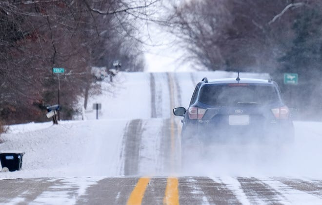 The Lansing area could receive from 5-8 inches of snow overnight Sunday and into Monday making travel on rural roads like Chandler in Clinton County more challenging. Sunday, Jan. 27, 2019.