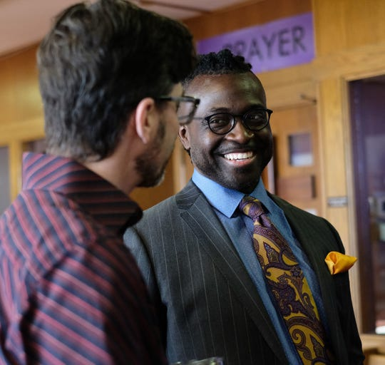 """Senior Pastor Sean Holland, at right, greets Pastor Tom Arthur of Sycamore Creek Church before services in 2019. Holland is among religious leaders now trying to serve church members in a time of """"social distancing"""" due to concerns about COVID-19."""