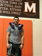 2015 Mansfield Senior grad and current assistant wrestling coach Jesse Palser is on a mission to open a shoe bank allowing Mansfield youngsters who cannot afford wrestling shoes the opportunity to borrow a pair in order to compete.