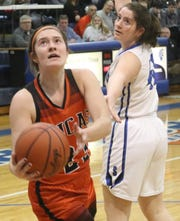 Lucas' Paige Arnold leads the Lady Cubs into battle against Willard at the Wayne Roller Holiday Showcase.