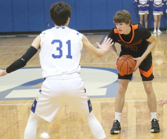 Lucas senior Carson Hauger waits for a play to develop during the Cubs' season-opening victory over St. Peter's on Friday night.