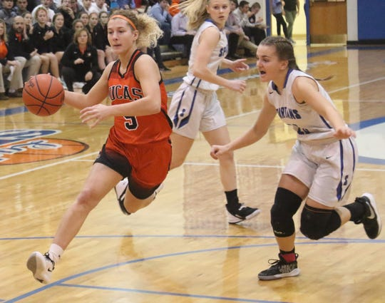 Lucas' Jamie Grover drives to the hoop during the first quarter of the Lady Cubs' win over St. Peter's on Friday night.