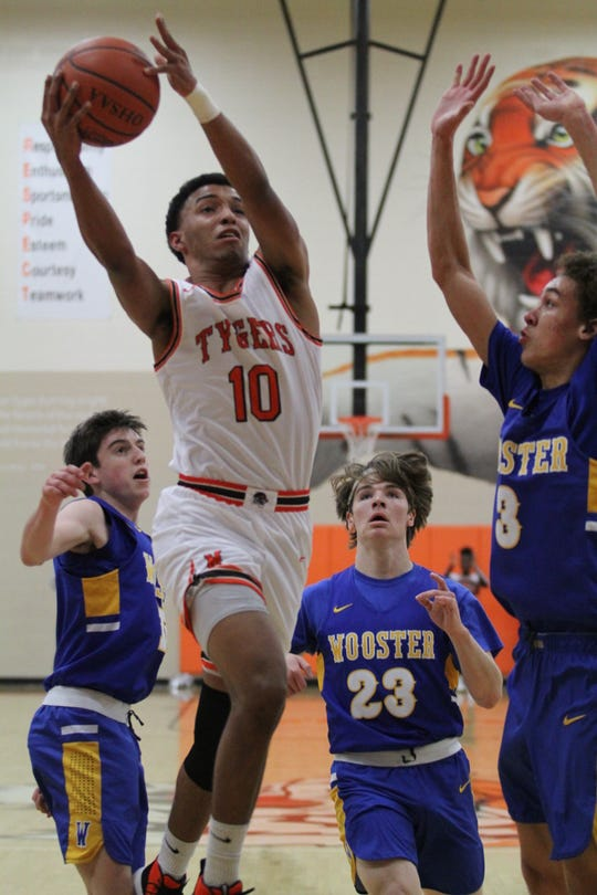 Mansfield Senior's Cameron Todd sank a buzzer-beating 3-pointer in the Tygers' 51-50 win over Akron Hoban on Saturday. It was the first win of the year for Mansfield Senior.