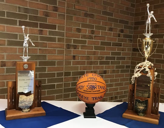 The game ball along with two trophies from 1980 stood in the doorway of the Franciscan Center for all to see as the Spartans honored the 1980 state championship girls basketball team on Friday night.